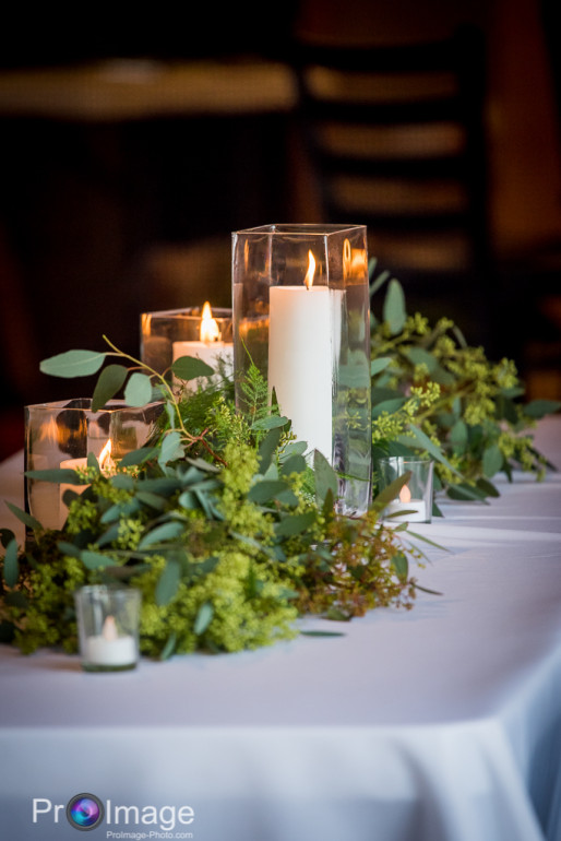 Hurricanes, Votive Candles, & Greenery by Boise Events