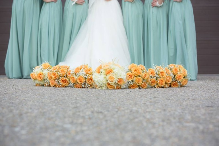 Light Blue Bridesmaide Dress with Orange Rose Bouquet
