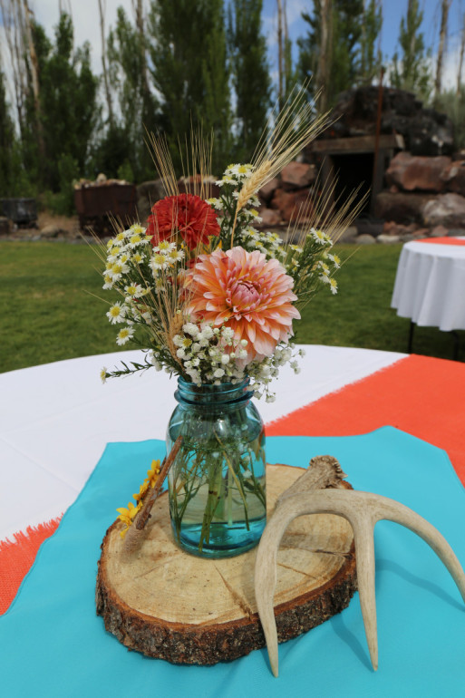 Wood Rounds, Blue Mason Jars, & Flowers by Boise Events